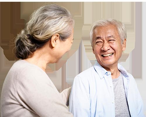 Happy asian senior couple talking in hospital ward